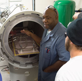 Man in front of autoclave