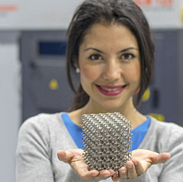 Woman holding a prototype