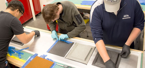 Students working with composites in the lab